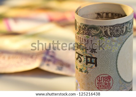 Japan Yen in front of multi national bank note - stock photo