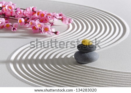 Japan zen garden of meditation with stone and structure in sand - stock photo