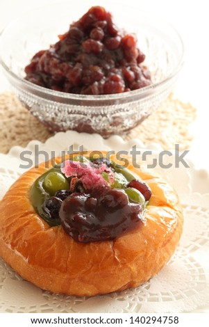 Japanese azuki bread and red bean paste on white background with copy space