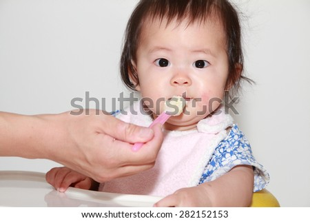 Japanese baby girl eating baby food (0 year old)