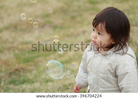 Japanese baby girl playing with bubble (1 year old)