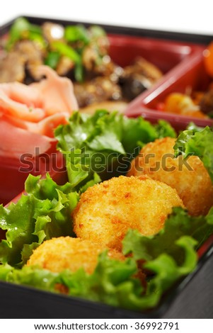 Japanese Bento Lunch - Mushrooms Salad with Hot Rice Appetizer and Hot Roll - stock photo