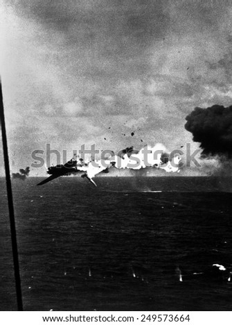 Japanese bomber explodes after direct hit by 5 inch shell from USS Yorktown, Dec. 4, 1943. Off Kwajalein Atoll. World War 2, Pacific Ocean. - stock photo