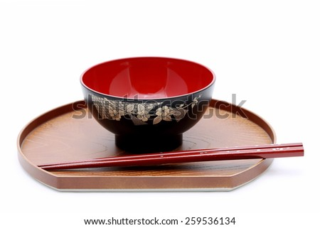 Japanese bowl and chopsticks on wooden tray  - stock photo
