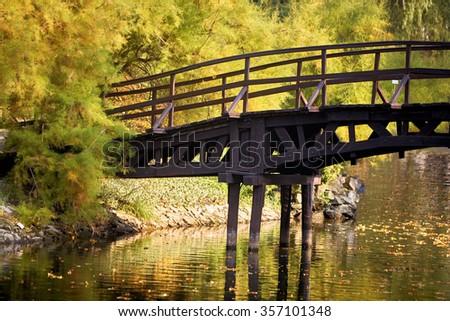 Japanese bridge over the lake - stock photo