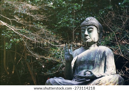 Japanese buddha statue, Seated Buddha statue at temple in Japan. - stock photo