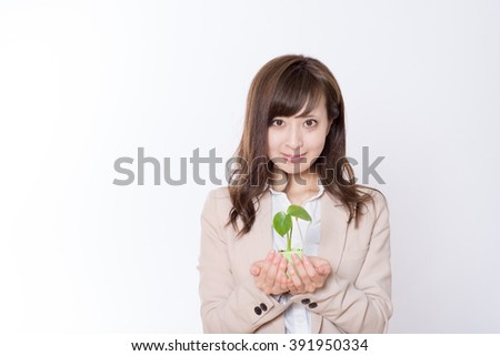Japanese business woman have sprout - stock photo