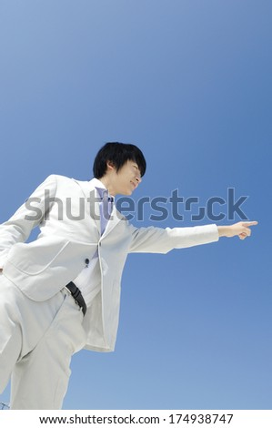 Japanese Businessman pointing
