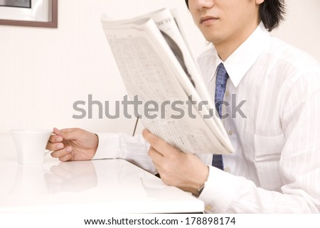 Japanese Businessman Reading newspaper
