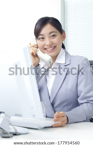 Japanese businesswoman having a telephone conversation
