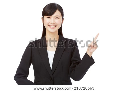 Japanese businesswoman pointing side