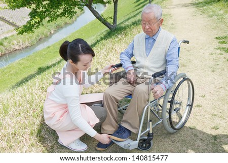 Japanese caregivers and senior in the field