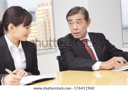 Japanese CEO and secretary at a meeting