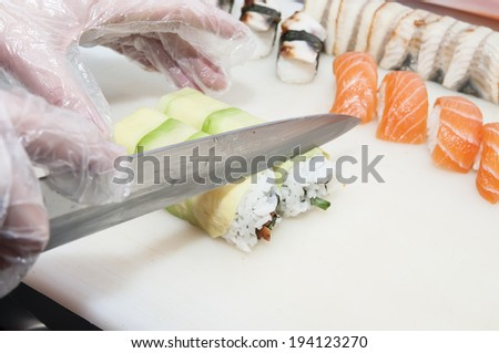 Japanese chef preparing a meal in a restaurant - stock photo