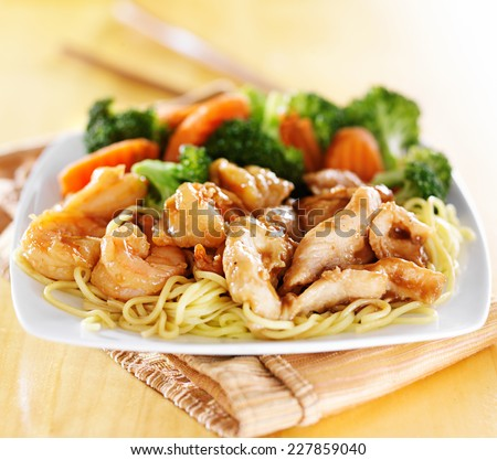 japanese chicken and shrimp teriyaki on noodles - stock photo