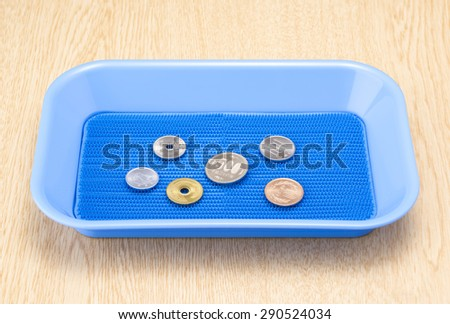 japanese coins in payment tray - stock photo