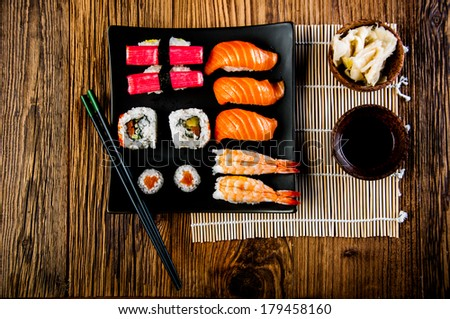 Japanese concept with sushi on the wooden table - stock photo