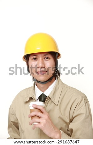 Japanese construction worker takes a coffee break