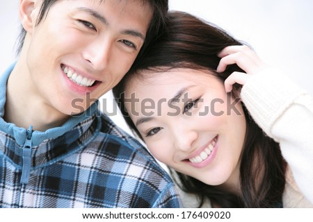 Japanese Couple smiling and walking - stock photo