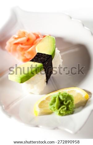 Japanese Cuisine -  Avocado Nigiri Sushi with Ginger and Wasabi - stock photo