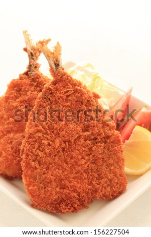 Japanese cuisine, deep fried horse mackerel served with sliced cabbage and tomato - stock photo
