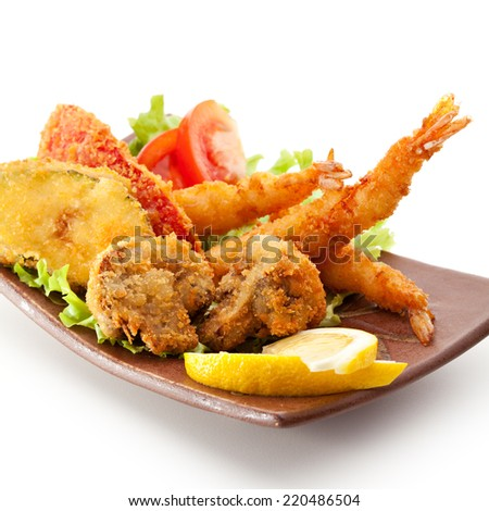 Japanese Cuisine - Deep Fried Shrimps, Vegetables and Mushrooms - stock photo