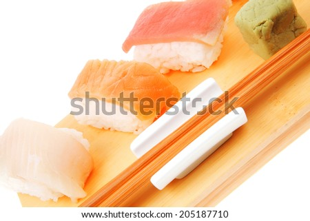 Japanese Cuisine - Different Types of Nigiri Sushi : Tuna (maguro) Salmon (sake) and Eel (unagi) with Wasabi on wooden plate isolated over white background - stock photo