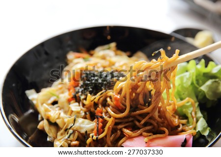 Japanese cuisine, fried noodles Yakisoba  - stock photo