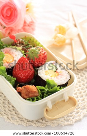 Japanese cuisine, homemade roll sushi packed lunch bento - stock photo