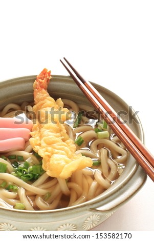 Japanese cuisine, hot pot Udon noodle with Tempura and Kamaboko - stock photo
