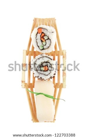 Japanese Cuisine - Maki Roll with Deep Fried Vegetables inside with Sashimi made of Smoked Salmon and Eel. on wooden boats . isolated over white background - stock photo