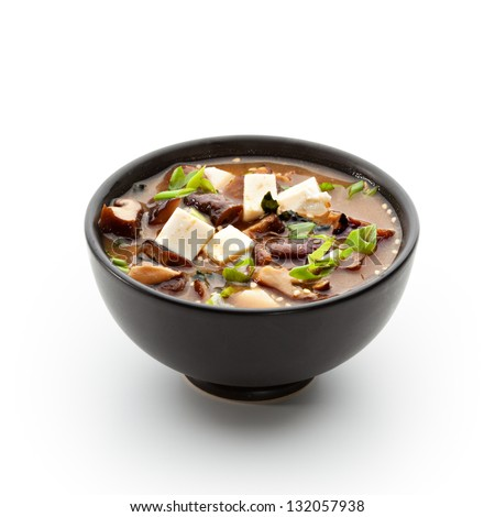 Japanese Cuisine - Miso Soup with Seaweed, Mushrooms and Tofu Cheese - stock photo