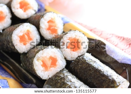 japanese cuisine, salmon sushi roll on food container for lunch pack image