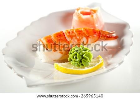Japanese Cuisine -  Shrimp Nigiri Sushi with Ginger and Wasabi - stock photo