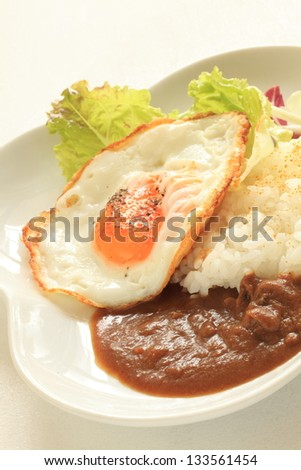 Japanese cuisine, sunny side up and curry rice for casual food image