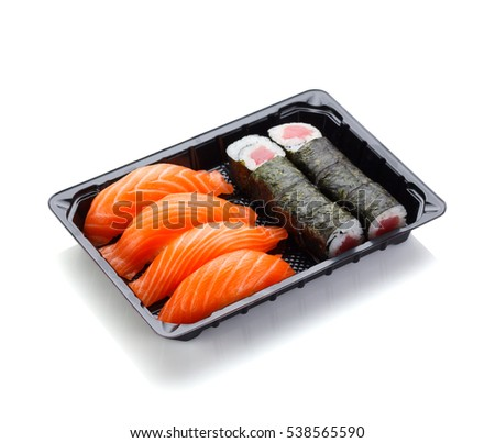 Japanese cuisine. Sushi nigiri and roll in a plastic box isolated on white background.