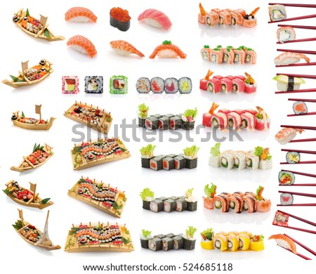 Japanese cuisine. Sushi set on a wooden plate isolated on white background