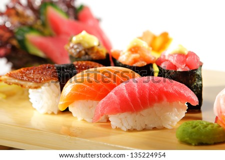 Japanese Cuisine - Sushi Set: Salmon, Conger and Tuna Sushi with Salad Leaf - stock photo