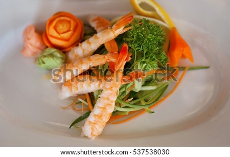 Japanese Cuisine, Sushi Set: sushi (shrimp) and sushi rolls on wooden plate, top view.