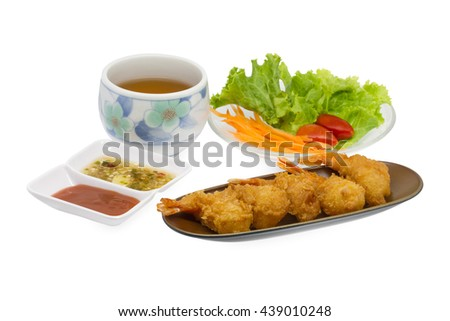 Japanese Cuisine - Tempura Shrimps (Deep Fried Shrimps) With ketchup and spicy sauce , vegetables and and cup of tea isolated on white background - stock photo