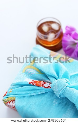 Japanese culture, Furoshiki Wrapped for summer gift image - stock photo