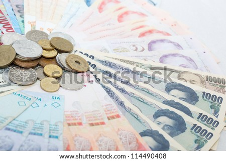 Japanese currency and South East Asia currency - stock photo