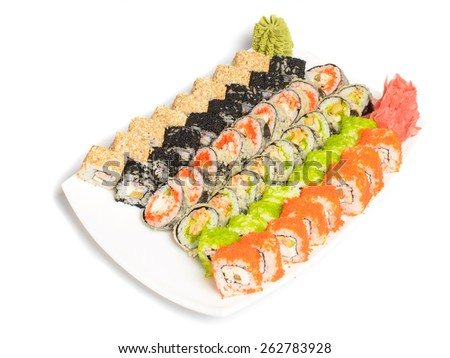 Japanese dish of different sushi rolls isolated on white - stock photo