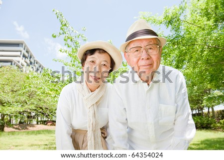 Japanese elderly couple peered - stock photo