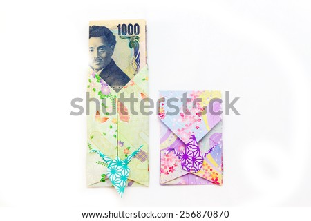 Japanese envelope decorated with a crane for presenting a gift of money in new year - stock photo
