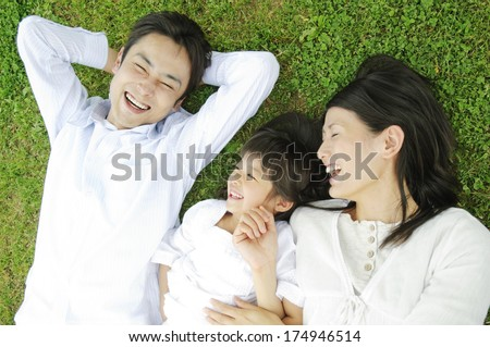 Japanese Family in the park - stock photo
