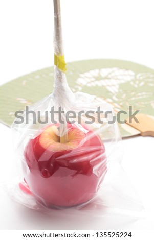 Japanese festival image, Candy apple with japanese fan on white background - stock photo