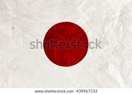 Japanese flag on a crumpled sheet of paper