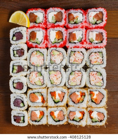 Japanese food. Assorted sushi on a wooden table, top view - stock photo