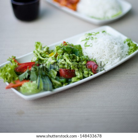 Japanese food. Chicken with rice and vegetables - stock photo
